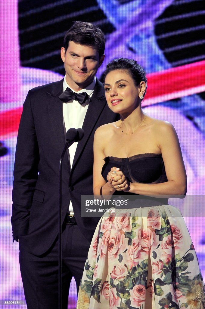Actors Ashton Kutcher (L) and Mila Kunis speak onstage during the 2018 Breakthrough Prize at NASA Ames Research Center on December 3, 2017 in Mountain View, California.