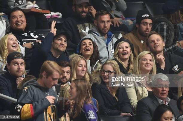 Actors Ashton Kutcher, Mila Kunis, and Elisha Cuthbert attend a game between the Vegas Golden Knights and the Los Angeles Kings at STAPLES Center on...
