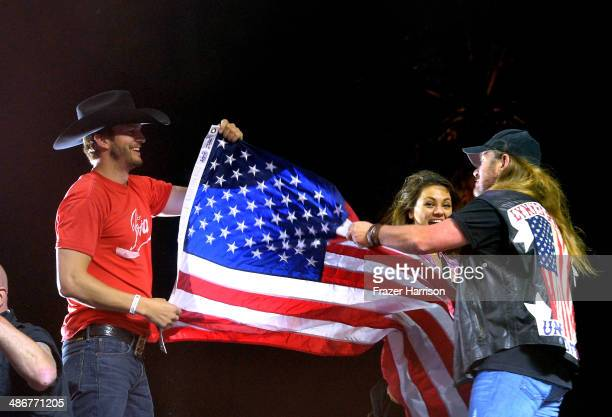 Actors Ashton Kutcher Mila Kunis and singer Johnny Van Zant of Lynyrd Skynyrd onstage during day 1 of 2014 Stagecoach California's Country Music...