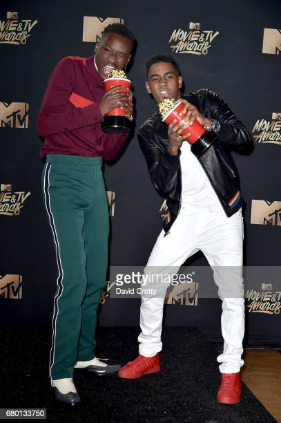 Actors Ashton Sanders and Jharrel Jerome winners of Best Kiss for 'Moonlight' pose in the press room during the 2017 MTV Movie And TV Awards at The...