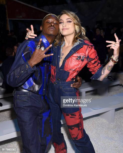 Actors Ashton Sanders and Paris Jackson attend the Calvin Klein Collection front row during New York Fashion Week at New York Stock Exchange on...
