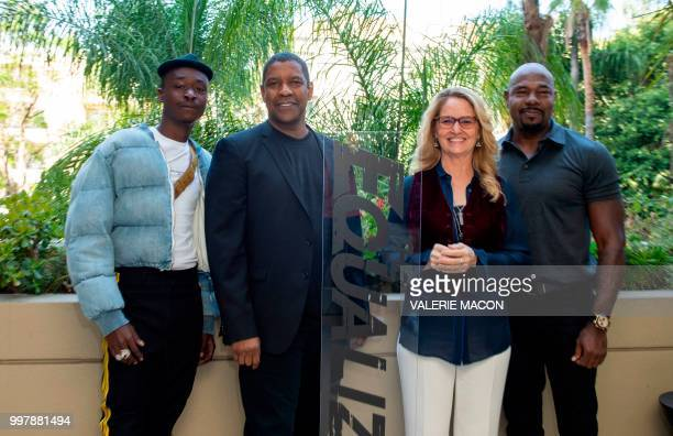Actors Ashton Sanders Denzel Washington Melissa Leo and director Antoine Fuqua pose during the 'Equalizer 2' photo call on July 13 in Beverly Hills...