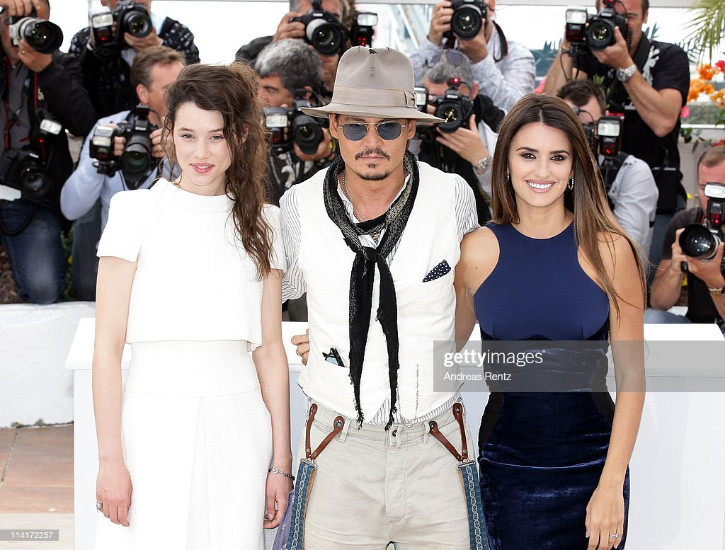 Actors Astrid Berges-Frisbey, Johnny Depp and Penelope Cruz attend the 'Pirates of the Caribbean: On Stranger Tides' photocall at the Palais des Festivals during the 64th Cannes Film Festival on May 14, 2011 in Cannes, France.