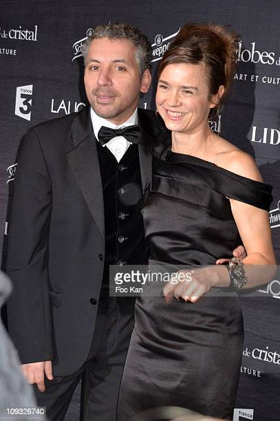 Actors Atmen Kelif and Caroline Proust attend the Globes de Cristal 2011 Awards Press Room at Le Lido on February 7 2011 in Paris France