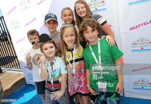 Actors August Maturo Ava Kolker and Cooper Friedman pose with fans at the Autograph Booth during the 17th Annual Mattel Party on the Pier on...