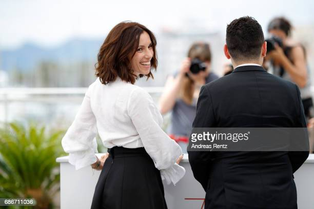 """Actors Aure Atika and Karim Moussaoui attend the """"Waiting For Swallows """" photocall during the 70th annual Cannes Film Festival at Palais des..."""