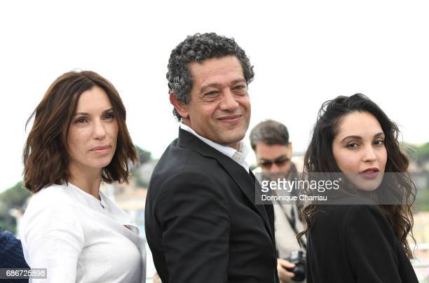 Actors Aure Atika Hassan Kachach and Hania Amar attend 'Waiting For Swallows ' photocall during the 70th annual Cannes Film Festival at Palais des...