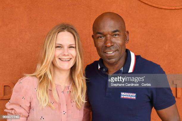 Actors Aurelie Nollet and Lucien JeanBaptiste attends the 2018 French Open Day Seven at Roland Garros on June 2 2018 in Paris France