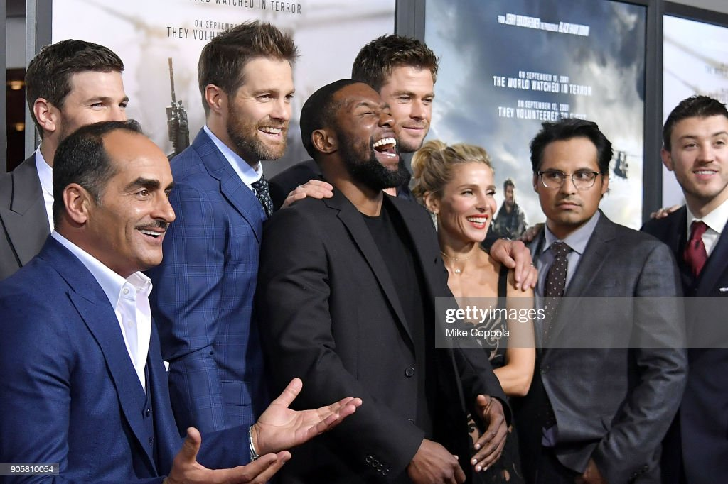 Actors Austin Stowell, Navid Negahban, Geoff Stults, Trevante Rhodes, Chris Hemsworth, Elsa Pataky, Michael Pena, and Austin Herbert attend the '12 Strong' World Premiere at Jazz at Lincoln Center on January 16, 2018 in New York City.