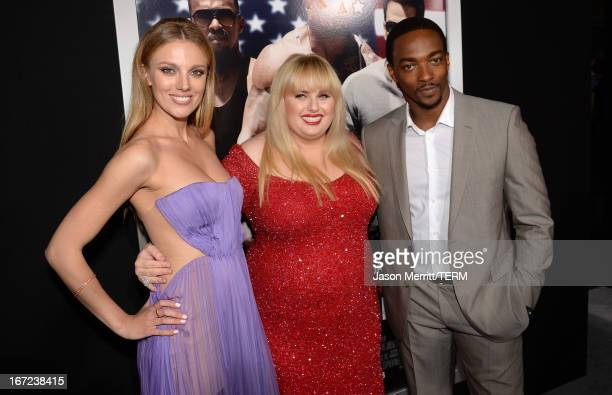 Actors Bar Paly Rebel Wilson and Anthony Mackie arrive at the premiere of Paramount Pictures' Pain Gain at TCL Chinese Theatre on April 22 2013 in...