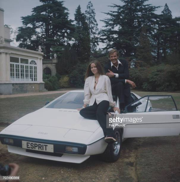 Actors Barbara Bach and Roger Moore, stars of the James Bond film 'The Spy Who Loved Me', sitting on the now-famous 'amphibious' Lotus Esprit at...