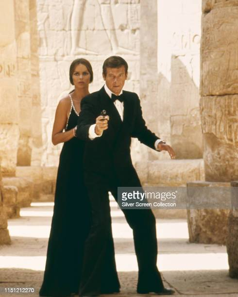 Actors Barbara Bach as Major Anya Amasova/Agent XXX and Roger Moore as James Bond at the temple of Karnak in Egypt in the film 'The Spy Who Loved Me'...