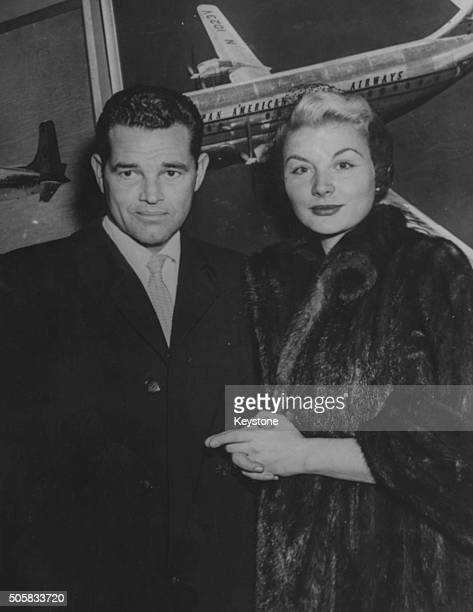 Actors Barbara Payton and Tom Neal pictured on their arrival from England to attend to her son who is ill with polio in America January 10th 1952