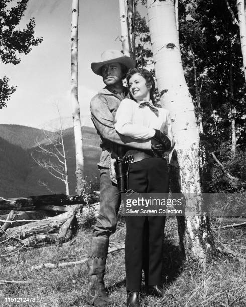 Actors Barbara Stanwyck as Kit Banion and Scott Brady as Sundance in the Western 'The Maverick Queen' 1956