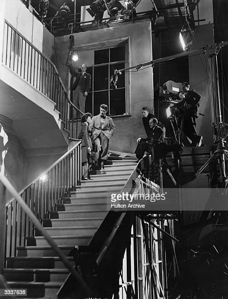 Actors Barbara White and Michael Allen act out a scene for the Associated British Pictures film 'While The Sun Shines' a screen adaptation of the...