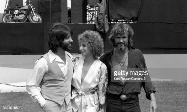 Actors Barbra Streisand Kris Kristopherson and producer Jon Peters are photographed on the set of 'A Star is Born' in 1976 at Sun Devil Stadium in...