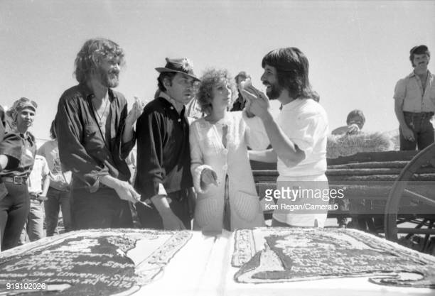 Actors Barbra Streisand Kris Kristopherson Bill Graham and producer Jon Peters are photographed on the set of 'A Star is Born' in 1976 at Sun Devil...