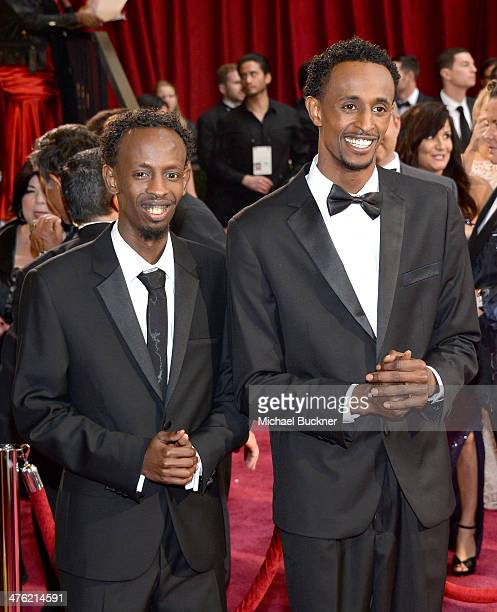 Actors Barkhad Abdi and Faysal Ahmed attend the Oscars held at Hollywood Highland Center on March 2 2014 in Hollywood California