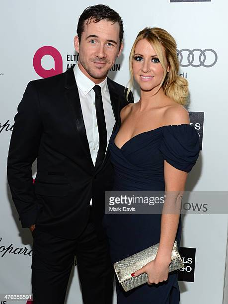 Actors Barry Sloane and Katy O'Grady attend the 22nd Annual Elton John AIDS Foundation's Oscar Viewing Party on March 2 2014 in Los Angeles California