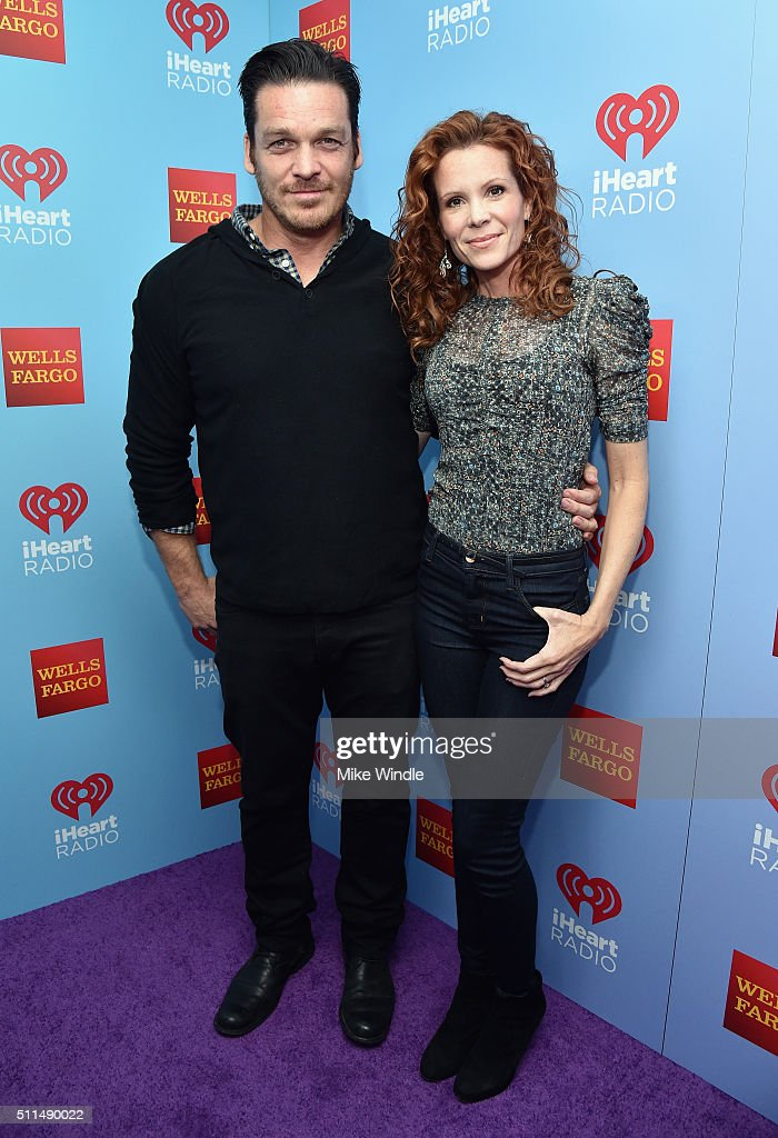 Actors Bart Johnson (L) and Robyn Lively pose backstage during the first ever iHeart80s Party at The Forum on February 20, 2016 in Inglewood, California.