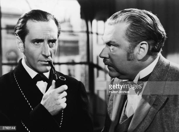 Actors Basil Rathbone and Nigel Bruce have a conversation in a still from the film 'The Adventures of Sherlock Holmes' directed by Alfred L Werker...