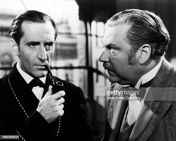 Actors Basil Rathbone as Sherlock Holmes and Nigel Bruce as Doctor Watson in the film 'The Adventures of Sherlock Holmes' 1939