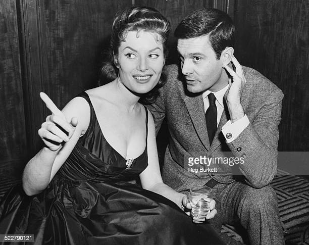 Actors Belinda Lee and Louis Jourdan chatting starring together in the film 'Dangerous Exile' London March 20th 1957
