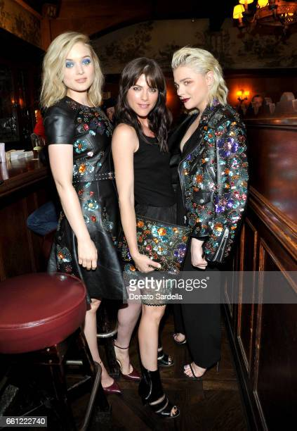 Actors Bella Heathcote Selma Blair and Chloe Grace Moretz attend the Coach Rodarte celebration for their Spring 2017 Collaboration at Musso Frank on...