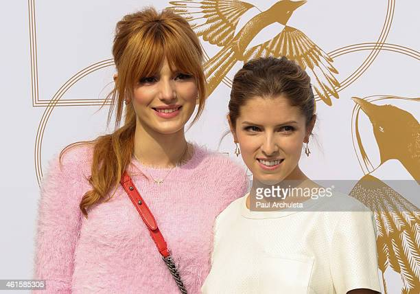 Actors Bella Thorne and Anna Kendrick attend the LoveGold event a celebration of Gold and Glamour at the Chateau Marmont on January 9 2014 in Los...