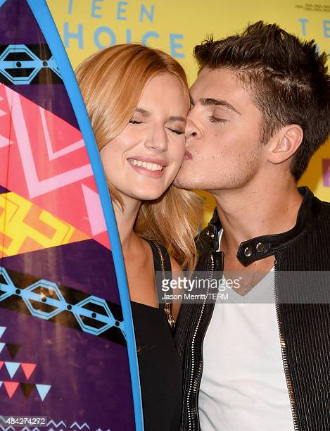 Actors Bella Thorne and Gregg Sulkin pose in the press room during the Teen Choice Awards 2015 at the USC Galen Center on August 16 2015 in Los...