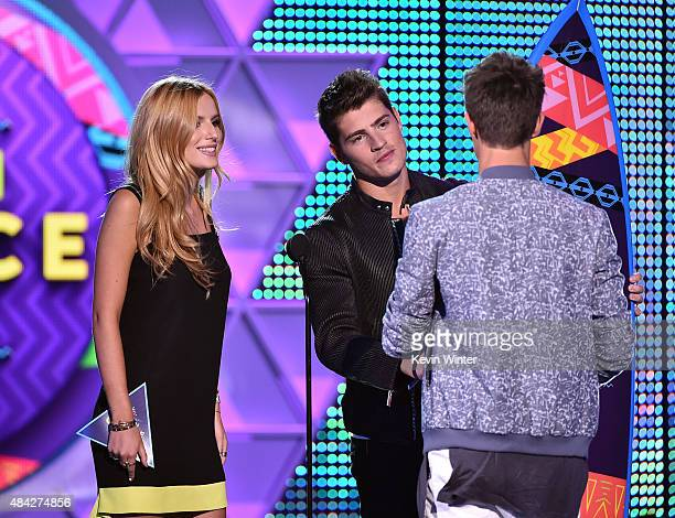 Actors Bella Thorne and Gregg Sulkin present internet personality Cameron Dallas with the Choice Web Star Male Award onstage during the Teen Choice...