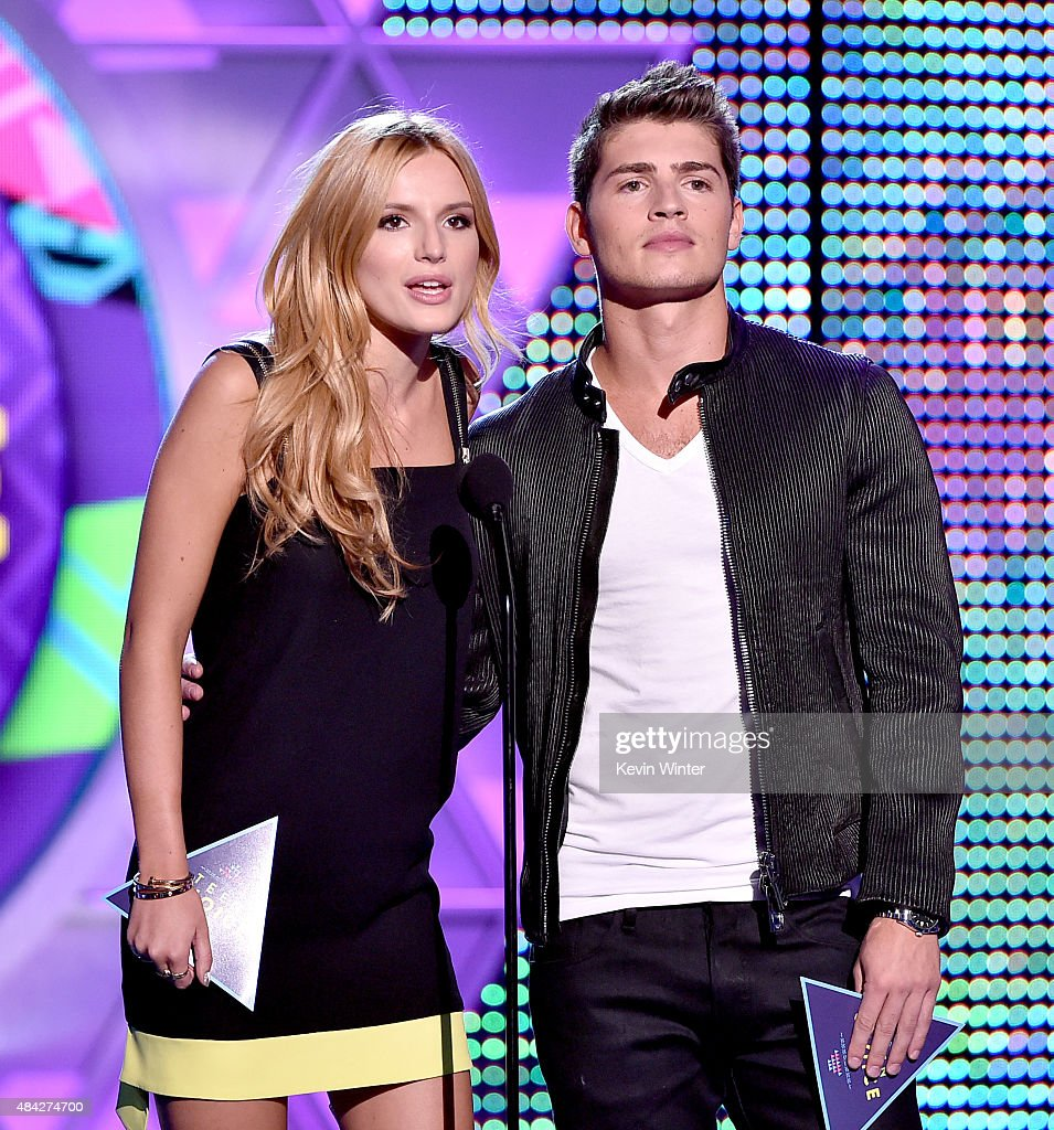 Actors Bella Thorne (L) and Gregg Sulkin speak onstage during the Teen Choice Awards 2015 at the USC Galen Center on August 16, 2015 in Los Angeles, California.