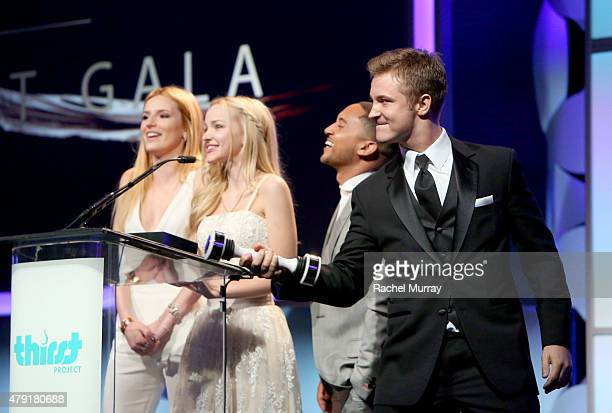 Actors Bella Thorne Dove Cameron Tahj Mowry and Michael Welch speak onstage during the 6th Annual Thirst Gala at The Beverly Hilton Hotel on June 30...