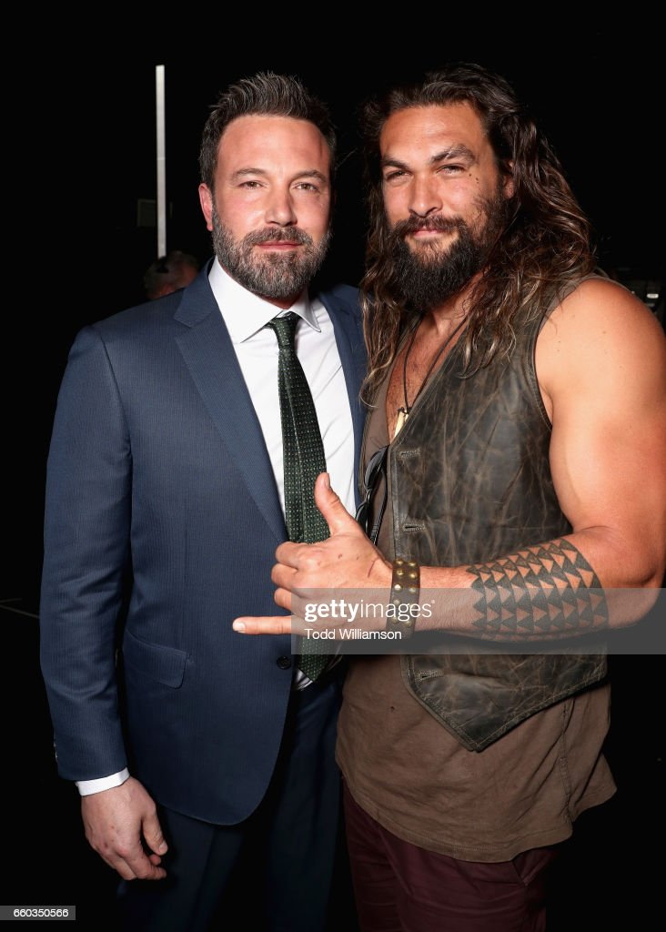 "Actors Ben Affleck (L) and Jason Momoa at CinemaCon 2017 Warner Bros. Pictures Invites You to ""The Big Picture"", an Exclusive Presentation of our Upcoming Slate at The Colosseum at Caesars Palace during CinemaCon, the official convention of the National Association of Theatre Owners, on March 29, 2017 in Las Vegas, Nevada."
