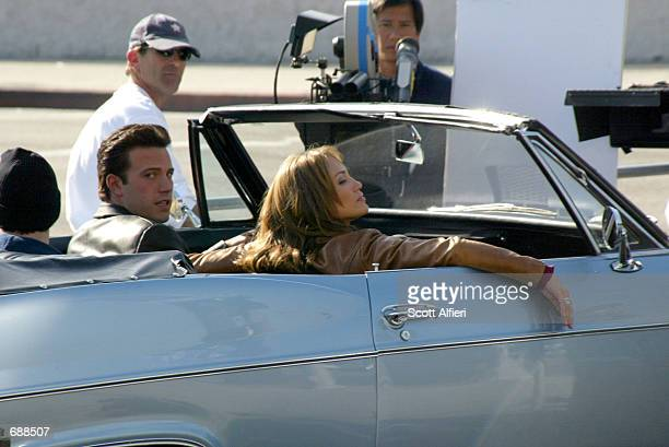 Actors Ben Affleck and Jennifer Lopez prepare to film a scene on the set of their upcoming movie Gigli December 19 2001 in Los Angeles CA