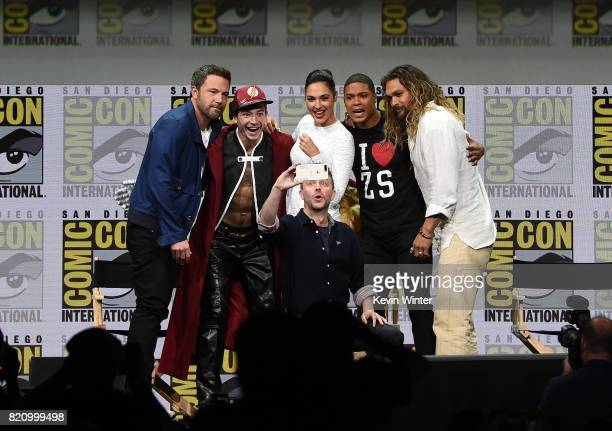 Actors Ben Affleck Ezra Miller Gal Gadot Ray Fisher and Jason Momoa from 'Justice League' attend the Warner Bros Pictures Presentation while...