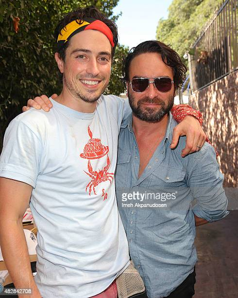 Actors Ben Feldman and Johnny Galecki attend Crab Cake LA on August 2 2015 in Los Angeles California