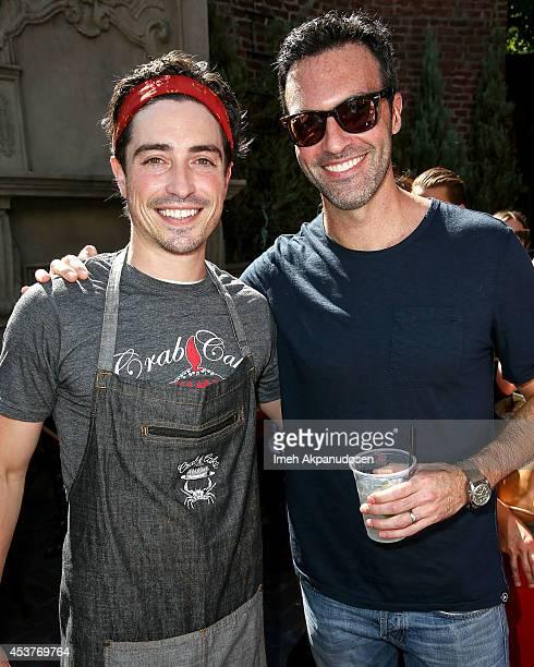 Actors Ben Feldman and Reid Scott attend Crab Cake 2014 presented by S Pellegrino Samsung Galaxy on August 17 2014 in Los Angeles California