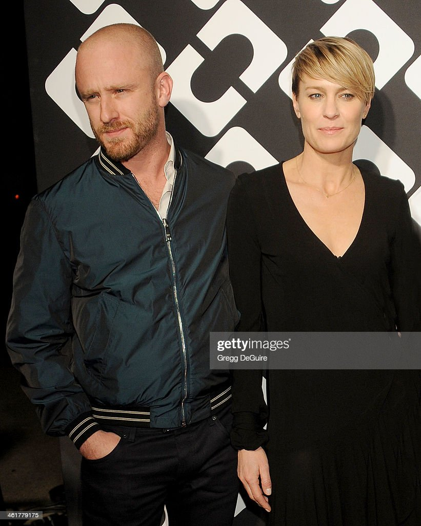 Actors Ben Foster and Robin Wright arrive at Diane Von Furstenberg's 'Journey Of A Dress' premiere opening party at Wilshire May Company Building on January 10, 2014 in Los Angeles, California.