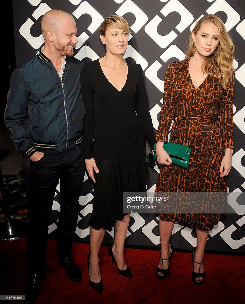 Actors Ben Foster, Robin Wright and Dylan Penn arrive at Diane Von Furstenberg's 'Journey Of A Dress' premiere opening party at Wilshire May Company Building on January 10, 2014 in Los Angeles, California.