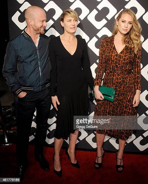 Actors Ben Foster Robin Wright and Dylan Penn arrive at Diane Von Furstenberg's Journey Of A Dress premiere opening party at Wilshire May Company...