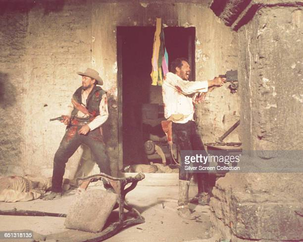 Actors Ben Johnson and Warren Oates in a scene from the western 'The Wild Bunch' 1969
