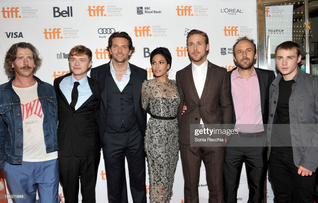 Actors Ben Mendelsohn, Dane DeHaan, Bradley Cooper, Eva Mendes, Ryan Gosling, Writer/Director Derek Cianfrance and actor Emory Cohen attend 'The Place Beyond The Pines' premiere during the 2012 Toronto International Film Festival at Princess of Wales Theatre on September 7, 2012 in Toronto, Canada.