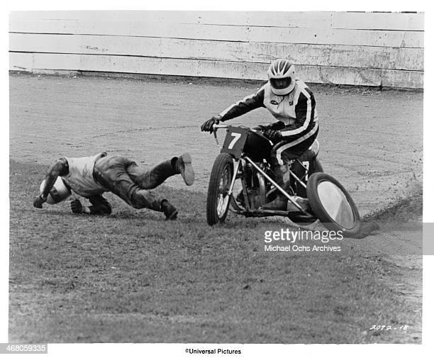 """Actors Ben Murphy and John Clayton on set of the movie """"Sidecar Racers"""" circa 1975."""