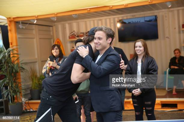 Actors Ben Robson and Finn Cole hug during TNT Animal Kingdom at SXSW 2017 on March 11 2017 in Austin Texas
