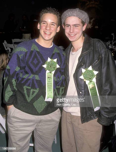 Actors Ben Savage and Rider Strong attend the 64th Annual Hollywood Christmas Parade on December 3 1995 at KTLA Studios in Hollywood California