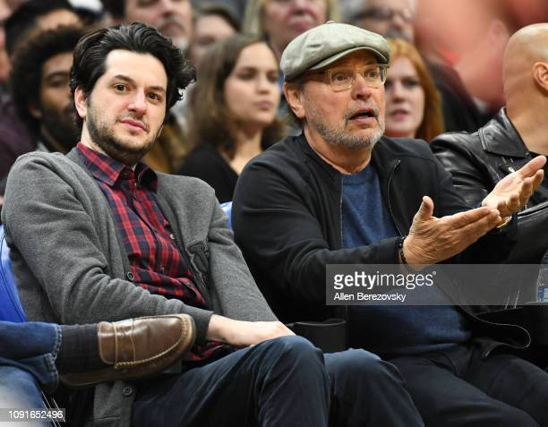 Actors Ben Schwartz and Billy Crystal attend a basketball game between the Los Angeles Clippers and the Charlotte Hornets at Staples Center on...