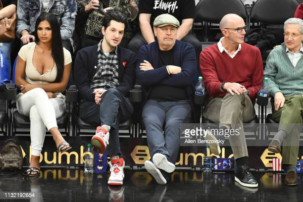 Actors Ben Schwartz and Billy Crystal attend a basketball game between the Los Angeles Clippers and the Dallas Mavericks at Staples Center on...