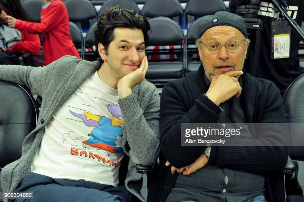 Actors Ben Schwartz and Billy Crystal attend a basketball game between the Los Angeles Clippers and the Denver Nuggets at Staples Center on January...