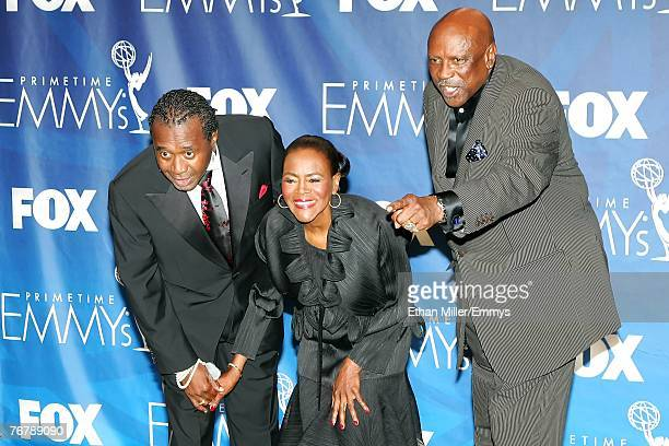 """Actors Ben Vereen, Cicely Tyson, and John Amos of """"Roots"""" pose in the press room during the 59th Annual Primetime Emmy Awards at the Shrine..."""